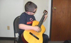 kids-guitar-lesson-101